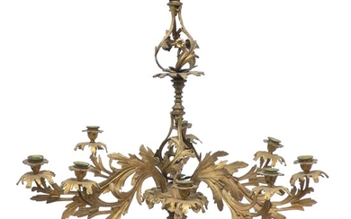 A French Rococo style gilt bronze and metal chandelier, profiled steam with seven candle holders....