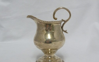 A George III silver cream jug, of squat baluster form with g...