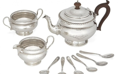 A George V silver three-piece tea set, Birmingham, c.1926, Mappin & Webb, comprising teapot, sugar and jug (jug not shown in photo, further images available upon request), each of rounded form with gadrooned rim, the teapot with wooden handle and...