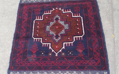 A HAND KNOTTED PURE WOOL PERSIAN BALUCHI