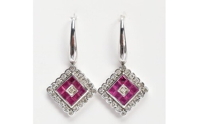 A PAIR OF WHITE METAL, DIAMOND AND RUBY DROP EARRINGS, each ...