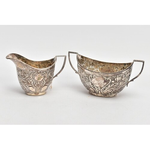 A SILVER CREAMER AND MATCHING SUGAR BOWL, the creamer emboss...