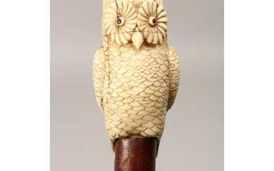 A VERY GOOD 19TH CENTURY CARVED IVORY OWL, RUSTIC WALKING CA...