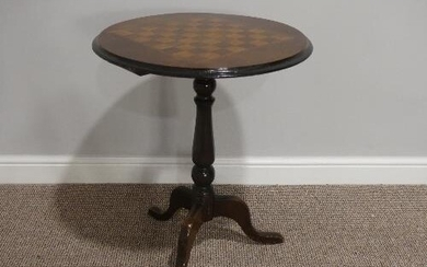 A Victorian walnut inlaid Tripod Table, the top inlaid with ...
