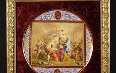 A Vienna Porcelain Plaque mounted in a carved giltwood...
