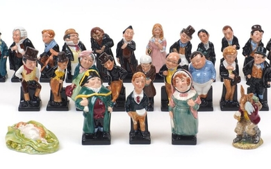 A collection of twenty four Royal Doulton Charles Dickens character figures, 20th Century, average height 11cm, together with a Royal Doulton Billie Bunnykins figurine, 'Cooling Off', 9.5cm high, and a Royal Albert Beatrix Potter figure, 'Timmy...