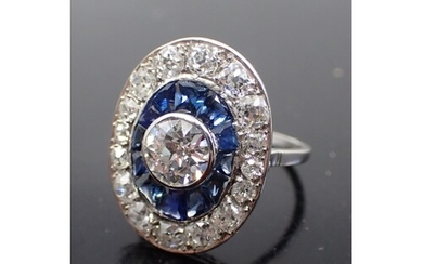 A diamond and sapphire cluster ring, estimated weight of cen...