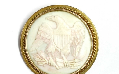 A gold mounted shell cameo brooch