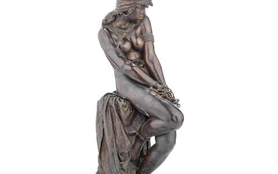 A late 19th century Italian patinated bronze figure of a Nubian slave cast by the Alessandro Nelli foundry, dated 1870