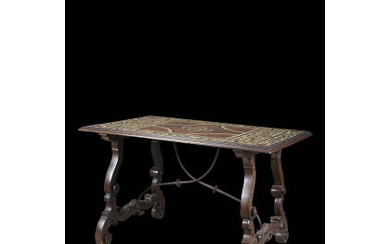 A mahogany and ebonized wood veneered centre table inlaid with floral motifs and decorated with bone and bakelite figures. Inscription…Read more