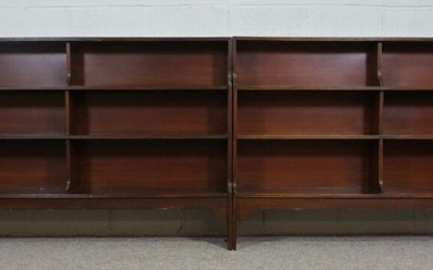 A pair of George III style mahogany waterfall open bookcases, 20th century, each with three