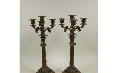 A pair of bronzed spelter three branch candlesticks on Corin...