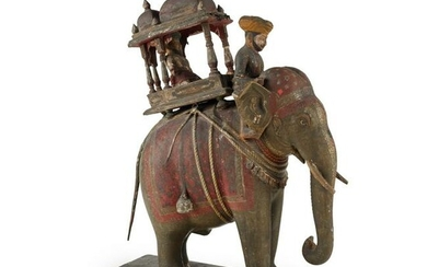AN INDIAN CARVED AND PAINTED WOOD AND GESSO MODEL OF AN