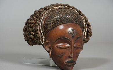 African dance mask carved in patinated wood, remnants...