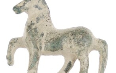 An attractive and decorative small bronze statuette of a standing...