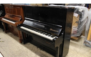 Bösendorfer (c1929) An upright piano in an ebonised case.