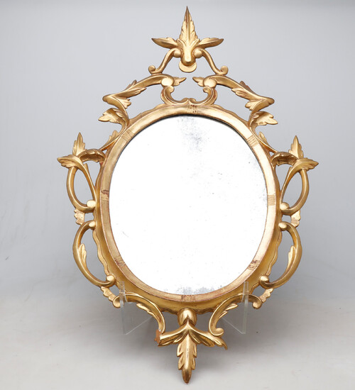 Spanish ornamental mirror with carved and gilded wood frame, 19th Century.