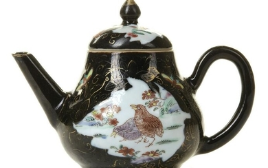 A CHINESE DARK-GROUND FAMILLE ROSE TEAPOT AND COVER