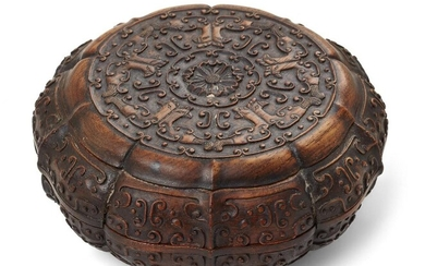 A Chinese carved suanzhi wood treasure box and cover, 18th/19th century, of decagonal lobed form atop a short foot, the cover carved with a flower encircled by birds and archaistic motifs, the sides carved with further archaistic motifs, with two...