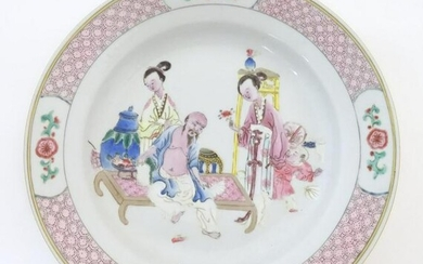 A Chinese famille rose plate decorated with an interior