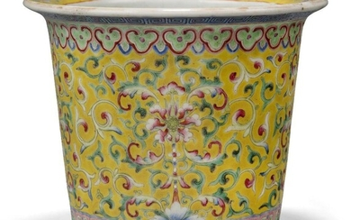 A Chinese porcelain famille rose jardiniere, late 19th century, painted to the body with continuous flowering lotus on a yellow ground, apocryphal iron red Qianlong mark to base, 14cm high Provenance: From the collection of an important Greek...