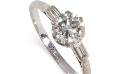 A DIAMOND SOLITAIRE ENGAGEMENT RING set with a round