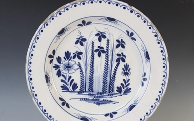 A Delft ware charger, 18th century, the tin glazed earthenwa...