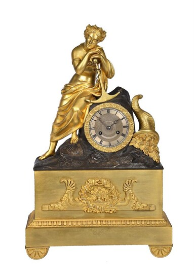 A FRENCH EMPIRE ORMOLU AND PATINTED BRONZE FIGURAL MANTEL CLOCK