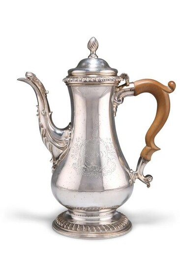 A GEORGE III SILVER COFFEE POT, by Thomas Whipham &