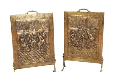 A PAIR OF BRASS FIRE SCREENS 19th century, decorated with pe...