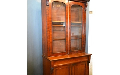 A Victorian Mahogany Bookcase, the moulded cornice above two...
