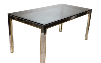 A chrome and brass dining table