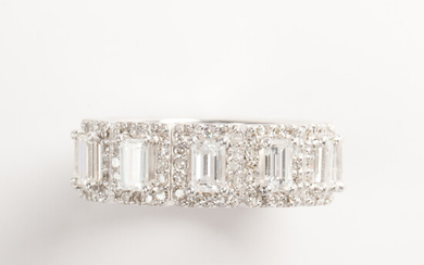 A diamond and eighteen karat white gold band ring