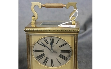 A late 19th century gilt brass carriage clock, of squat form...