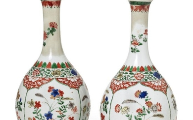 A pair of Chinese porcelain bottle vases, Kangxi period, painted...