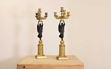 A pair of French Empire ormolu and bronze candelabra