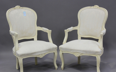 A pair of late 20th century French cream painted showframe fauteuil armchairs, height 91cm, width 63