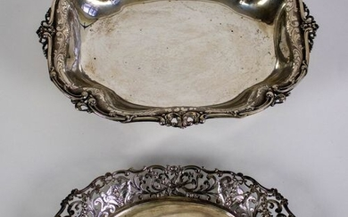 A silver bread basket and silver tray