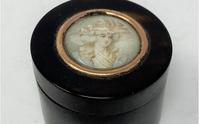 A tortoiseshell circular box and cover, the top inset a circ...