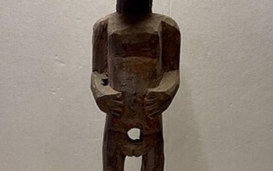 NOT SOLD. An African figure of carved wood. 20th century H. 65 cm. – Bruun Rasmussen Auctioneers of Fine Art
