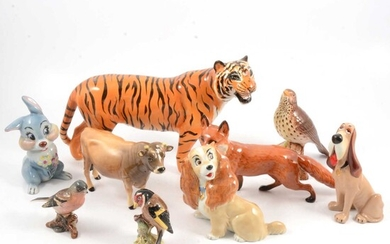 Beswick tiger and other animals and birds, and Wade Disney blow-ups.