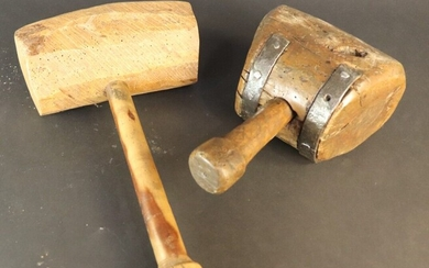 Two wooden carver's mallets. Arc-shaped mallet with slanting strokes