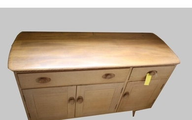 ERCOL SIDEBOARD Model No 351, a light elm and beech sideboar...