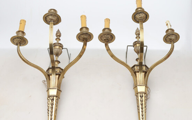 Pair of Louis XVI style brass wall lights, second third of the 20th Century.