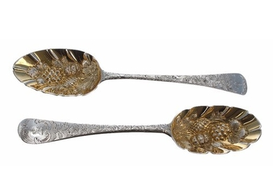 Two similar Georgian silver serving spoons, with gilt emboss...