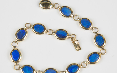 A 14ct gold and blue opal doublet oval link bracelet on an oval gold clasp, weight 7.2g, length 18.5