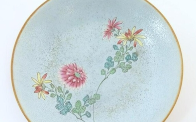 A Chinese plate with stylised peony flower detail.