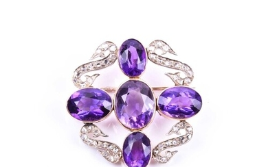 A diamond and amethyst brooch, set with four mixed oval-cut ...