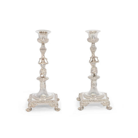 A pair of silver figural candlesticks
