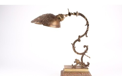An early 20th-century French gilt brass desk lamp, with scro...